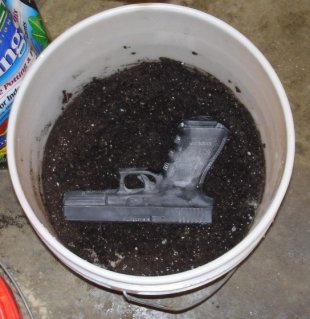 Glock 21 in Bucket of Mud